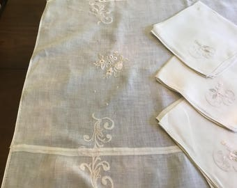 Linen embroidered table cloth with 3 matching napkins.