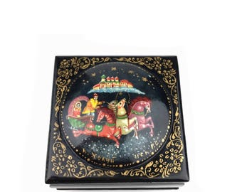 """Hand Painted Russian Souvenir Lacquered Box featuring a Chariot Race passing the Kremlin  1"""" Tall x 2"""" Wide x 2 1/2"""" Deep."""