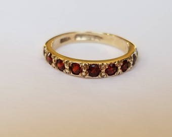 Vintage garnet band in yellow gold