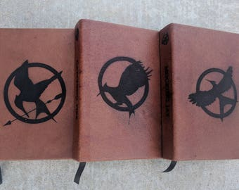 Leather Bound Hunger Games book series: The Hunger Games, Catching Fire and Mocking Jay.