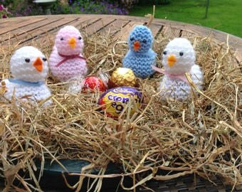 Cute chicks hand knitted to cover a variety of chocolates or a small gift. Ideal for a Christening or baby shower present.