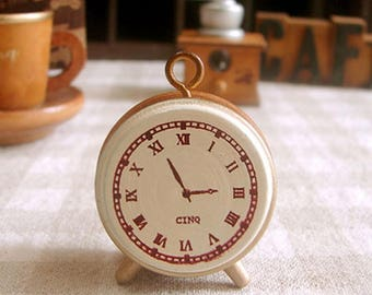 Wooden and rubber stamp imitation small alarm clock