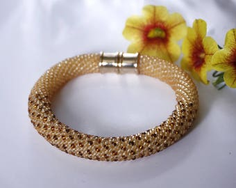 Boho style bracelet Beaded Crocheted in tender beige colors. Gold plated accessories. Gift for mom, for her.