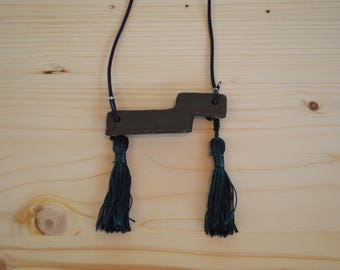 Black ceramic geometric necklace with dark green tassels