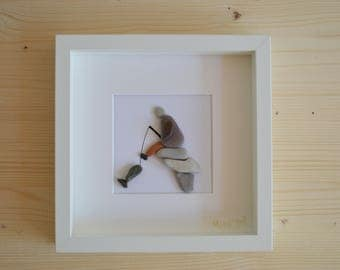 Beach pebble fisherman framed art
