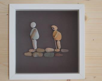 Beach pebble hikers framed art