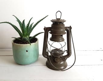 Old militairy storm lantern / oil lamp