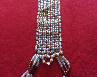 Beaded mystery object. Beads for upcycling. vintage. clear red and opaque white beads. Mother of pearl button.