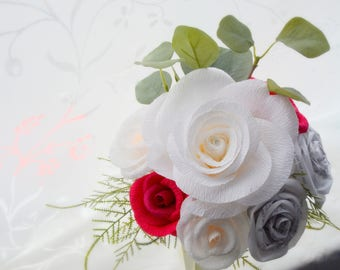 Red, white paper flower and book page rose wedding bouquet.
