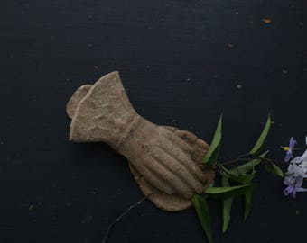 Old hand cast, letters, paper note clip