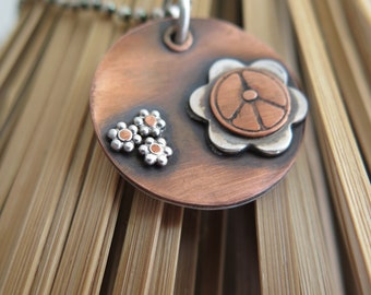 Peace sign. Sterling silver and copper pendant. Handmade one of a kind art jewelry