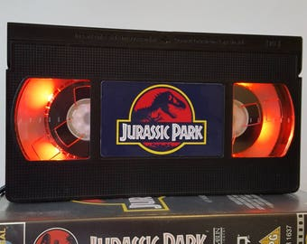 Retro VHS Lamp Jurassic Park Jurassic World Night Light Table Lamp. Order any movie, series, or actor! Great gift. Mancave. Mothers Day