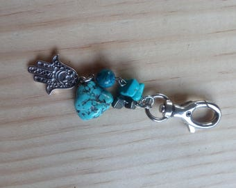 Turquoise bag clip.