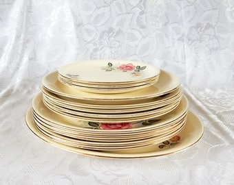 14 Rose Marie plates by Alfred Meakin