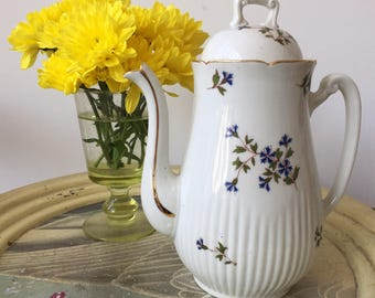 A Vintage Coffee Pot with Domed Lid decorated with Blue Flowers