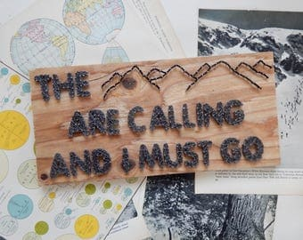 The mountains are calling and I must go john muir string art sign.