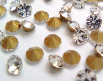 100 rhinestone faceted 2.5 mm silver spikes