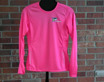 Long sleeved pink New Balance shirt with P is for Pickleball in Pink