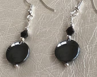 Black dangle earrings.  Hemitite dangle  earrings.  Embellished with black crystals.  Hanging on a silver ear wire.