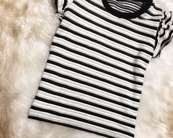 Black and grey flutter sleeve top