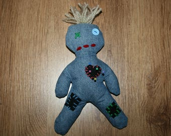 Voodoo doll with blond hair