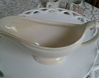 Antique white linen ironstone gravy pitcher.price reduced to25.00