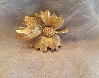 Monet gold tone leaf brooch.