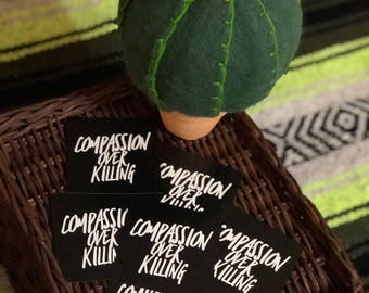 COMPASSION OVER KILLING vegan sticker