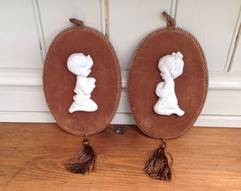 Vintage praying children wall plaques porcelain and velvet 1960s