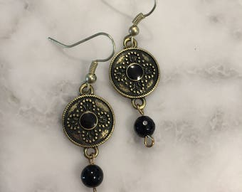 Gold and black medallion earrings