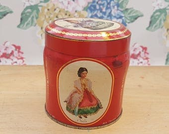 Vintage tin, Scribbans Kemp chocolate table fingers. Features dolls wearing the national dress of Switzerland, Spain, Italy, India