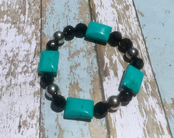 Turquoise, black, and silver beaded stretch bracelet