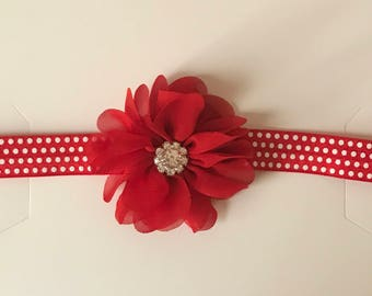 Red flower with red and white polka dot hair band