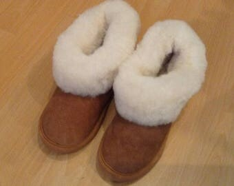 Slippers in 100% leather