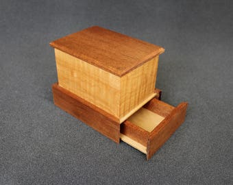 Keepsake box with hidden compartment