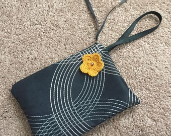 Black Clutch purse with gold crocheted flower