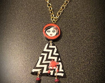 Pendant red and black doll