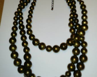 Vintage pre-owned triple strand antique brass balls statement necklace.
