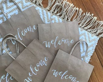 wedding welcome bags-kraft bags-welcome bags-hand lettered-custom gift bags-personalized gift bags-wedding favors-calligraphy