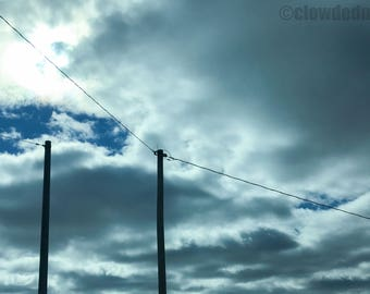 Photograph of clouds and telephone poles. 12x18 cloud photograph. Cloud photography. Nature photography. Clouds and sky.