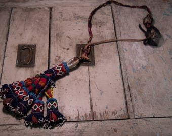 Afghan Kuchis pendant beads and embroidered fabric
