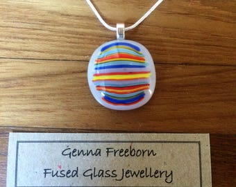 Handmade round rainbow stripe and white fused glass pendant