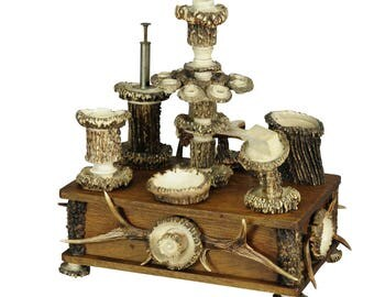 an elaborate handmade black forest style smoking set ca. 1900
