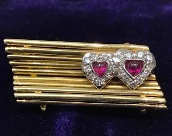Ruby, diamond and gold park bench brooch with twin hearts from the 1950s