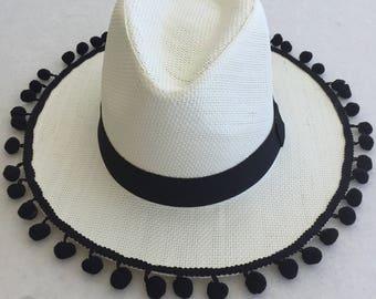 Handmade straw hat with pom-pom