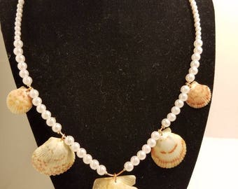 white faux pearl and seashell necklace on wire