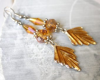 Topaz Brown earrings with charm leaf.