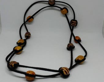 Handmade leather necklace with wooden beads