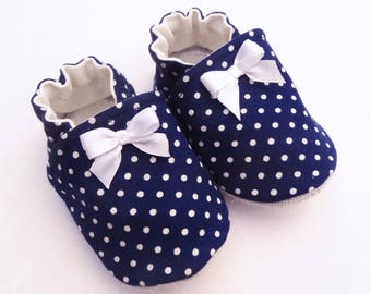 Sole leather baby booties and Navy blue cotton top with bows sewn on top.