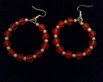 Red and grey dangle hoops .